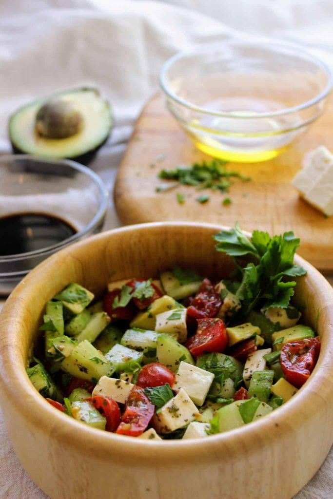 Caprese Avocado Salad is the perfect summer salad! It has the traditional caprese flavors with the addition of creamy avocado. This is definitely one of my favorite fresh salads and it's perfect for the keto diet! It's about this time of the summer that salads with greens are getting a little old, and that's when Caprese Avocado Salad is on my table. Crisp cucumber, creamy avocado, juicy tomato, fresh mozzarella, and a delicious balsamic vinegar make this low carb salad amazing! Try it out this Fourth of July or all summer long. #caprese #salad #CapreseAvocadoSalad #summer #summersalad #avocados #tomato #freshmozzarella #keto #ketogenic #lowcarb #fresh #fourthofjuly #food #diabeticrecipes #heartdisease #autoimmune #antiinflammatory #fitness #healthy #healthyfood #yum #cucumber #italian #balsamic #nocook #cholesterol