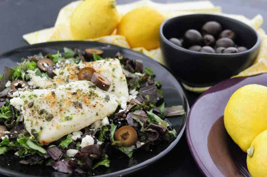 Easy Ketogenic Lemon Garlic Mediterranean Tilapia and Greek Salad Dressing. Have your omega 3's in this fish on a delicous bed of Greek Spinach Salad! #greek #greekketo #globalketo #greekspinachsalad #mediterranean #tilapia  #ketofish