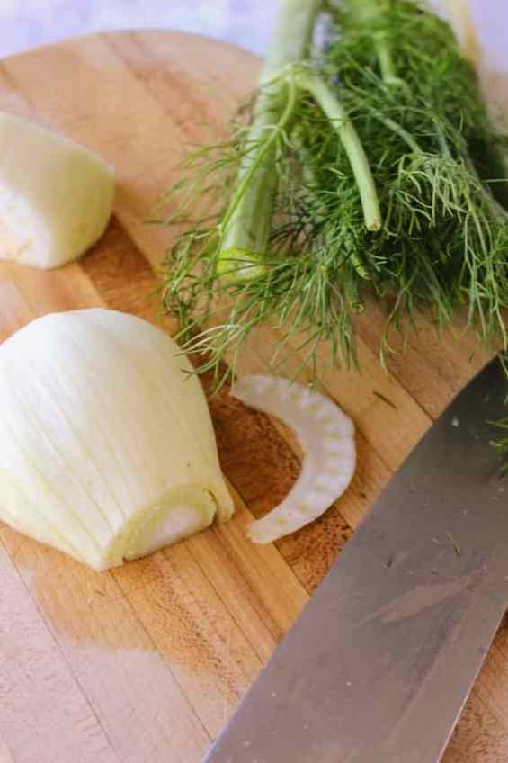 Fennel bulb being chopped on cutting board with knife set to side for corned beef and cabbage soup low carb recipe