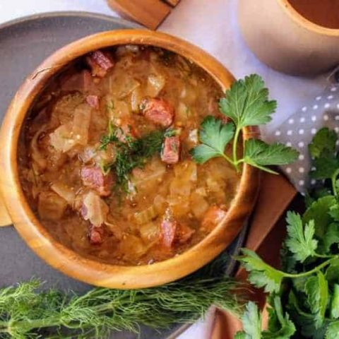 Corned beef and cabbage soup low carb recipe overhead shot in a wooden bowl with fresh parsley