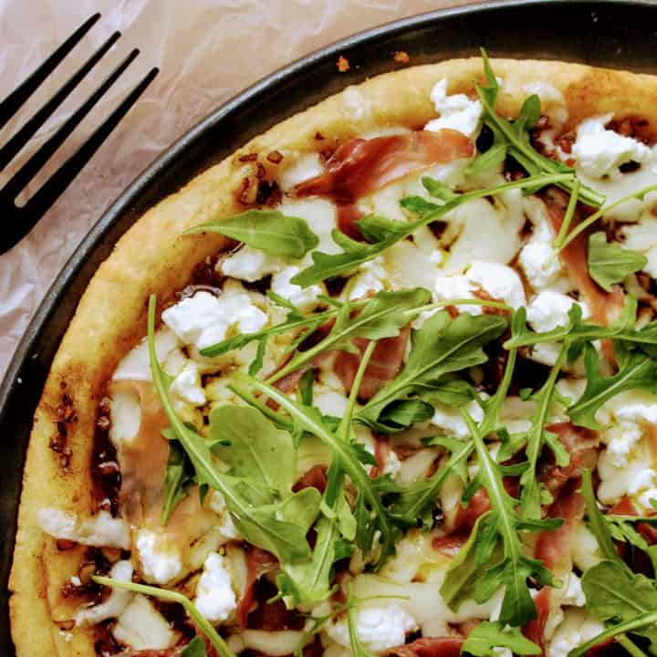 Keto Goat Cheese Pizza with Prosciutto and Arugula