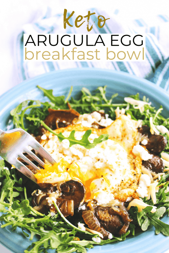 This keto arugula egg breakfast bowl with caramelized onions and mushrooms is topped with crumbled goat cheese. Keen for Keto | keto breakfast bowl | keto protein bowl