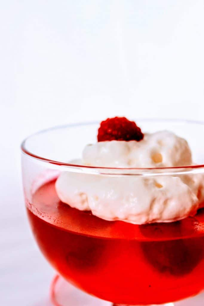 Sugar Free Jello Keto with whipped cream and raspberries